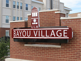 Photo of Bayou Village sign